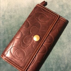 COACH. Embroidered design brown leather wallet.